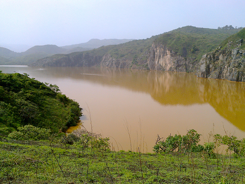 Lake Nyos, Cameroon, shows red coloration from iron oxides stirred up by the artificial degassing of carbon dioxide from the bottom water.