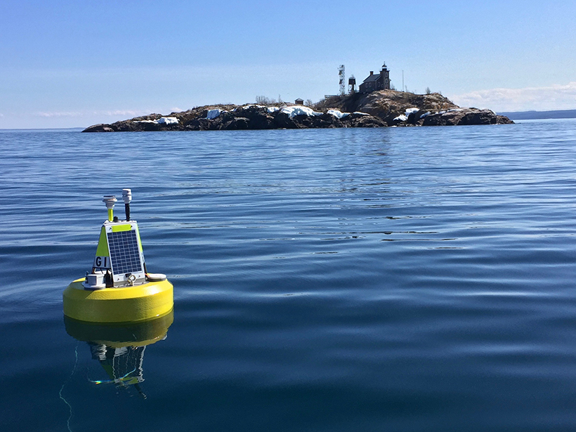 Environmental data buoy at Granite Island Light Station, a Great Lakes Evaporation Network site on Lake Superior.