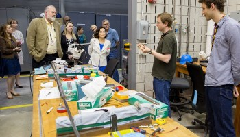 Córdova (in white blazer) tours the National High Magnetic Field Laboratory at Florida State University, Tallahassee, in March.