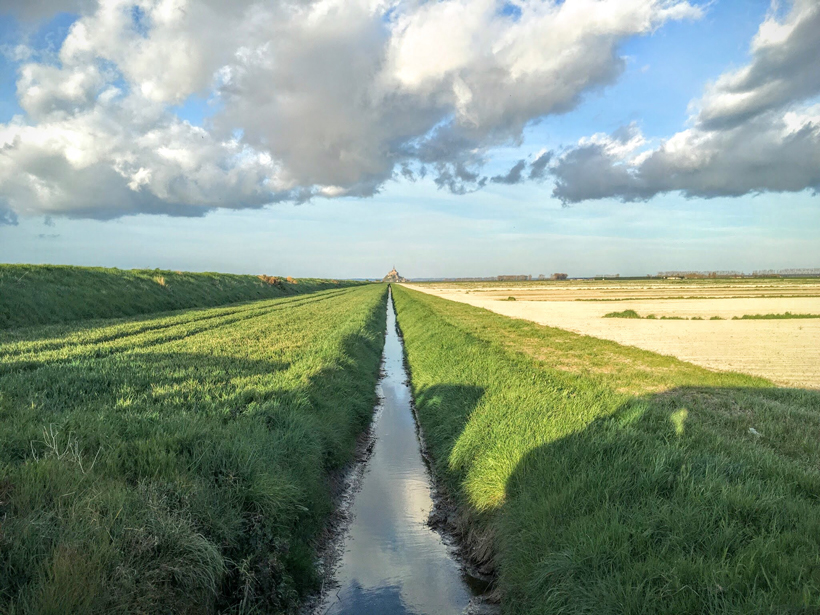 An irrigation ditch near the Mont Saint-Michel World Heritage Site in France.