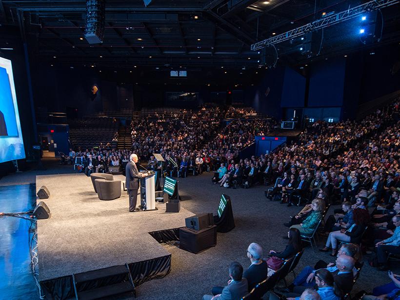 Veteran journalist Dan Rather speaks to a packed auditorium of AGU meeting attendees.