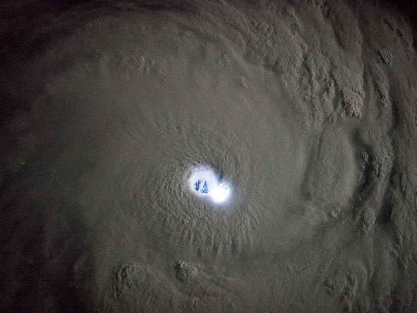 View from the International Space Station of lightning in Tropical Cyclone Bansi as it travels over the Indian Ocean in 2015.