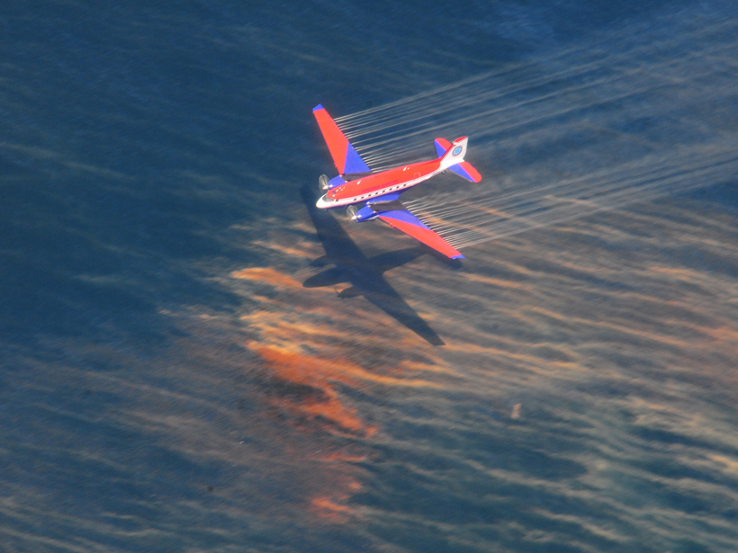 A Basler BT-67 fixed wing aircraft releases oil dispersant over oil from the Deepwater Horizon spill on 5 May 2010.