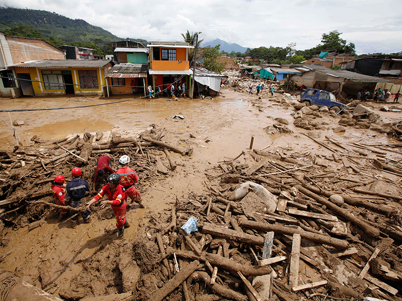 Rescuers search for survivors on 2 April 2017 after floodwaters carrying mud and debris inundated parts of Mocoa, Colombia.