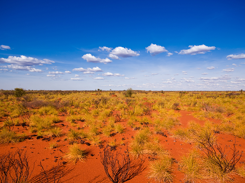 The flat Australian outback overlies a series of ancient mountain chains.