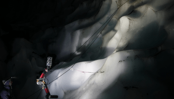 The ice-climbing robot IceWorm scales a wall in a glacial cave at Mount St. Hel