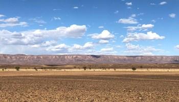 Mountains rise over a desert vista