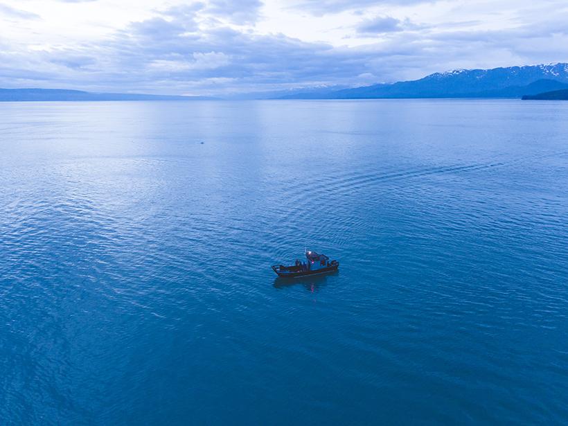 Boat alone on water in Alaska