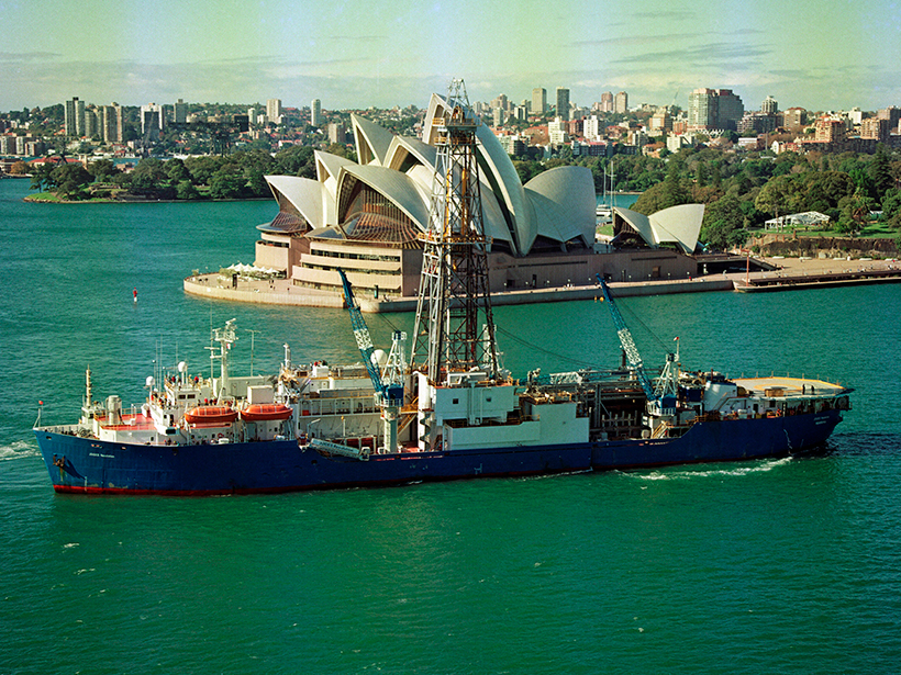 A research vessel traverses Sydney Harbor with the Sydney Opera House in the background.