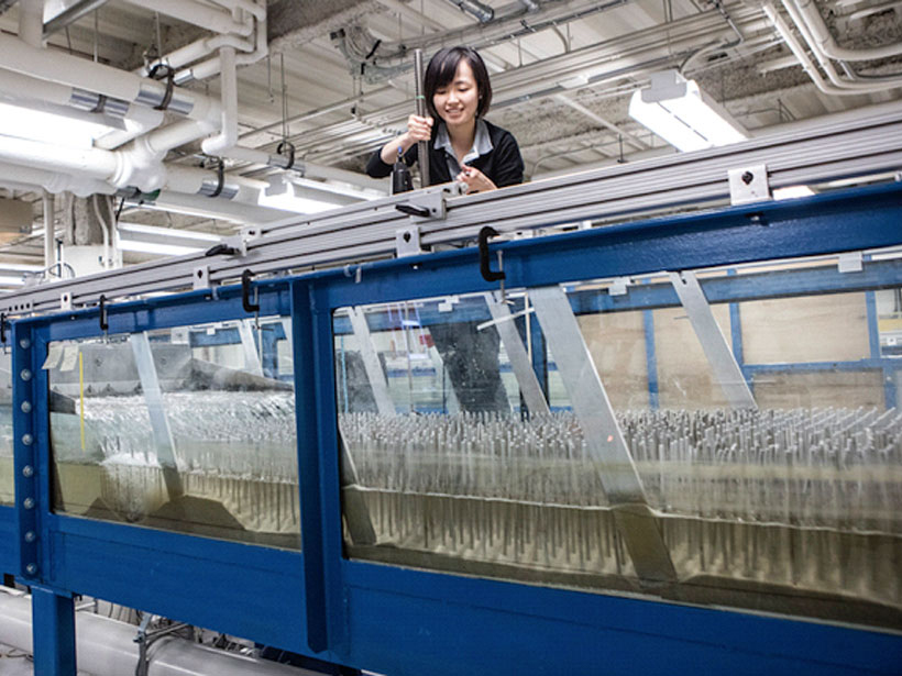 Judy Yang performing sediment movement experiments in a lab