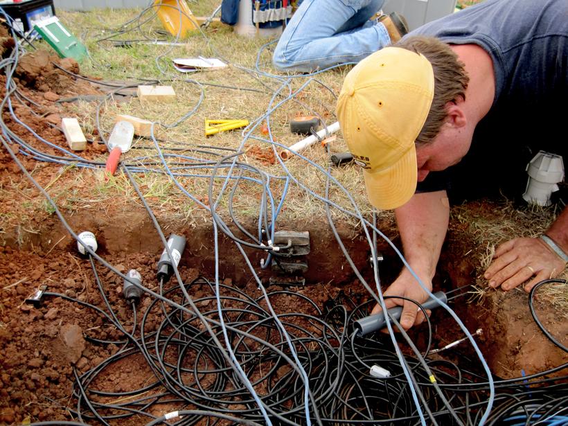 Michael Cosh installs soil moisture sensors near Stillwater, Okla., at the Marena, Oklahoma In Situ Sensor Testbed.
