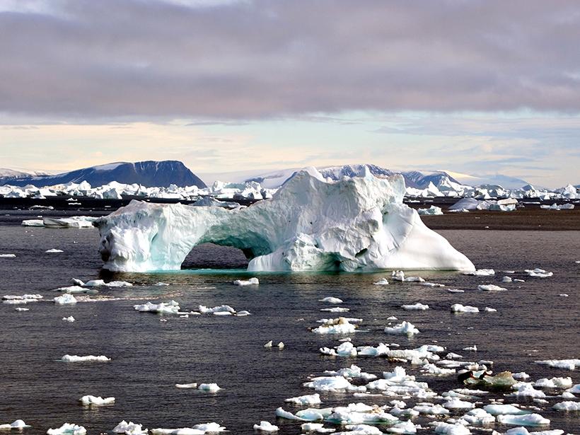 Seascape photo with a large iceberg
