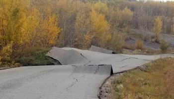 Buckled asphalt caused by a slow-moving landslide