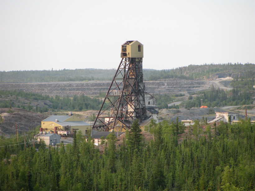The abandoned Giant Mine dominates a forested landscape
