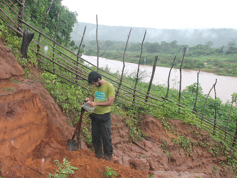 Vinícius Mendes collects a sediment sample from a former river terrace of the Parnaíba River in Brazil.