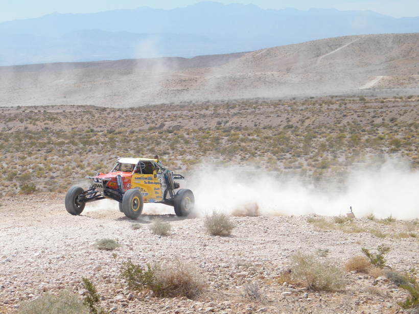 Off-road vehicle kicks up dust in the desert