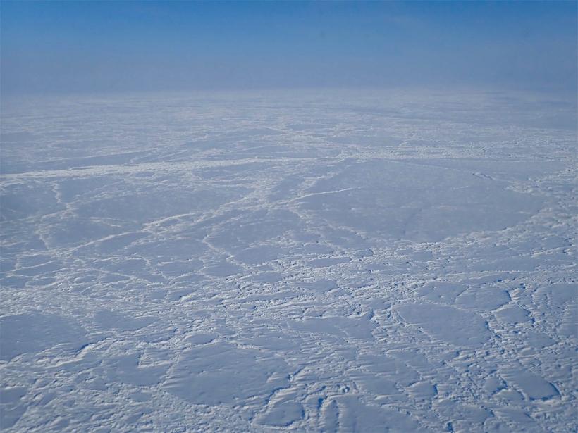 Aerial photo of sea ice extending to the horizon