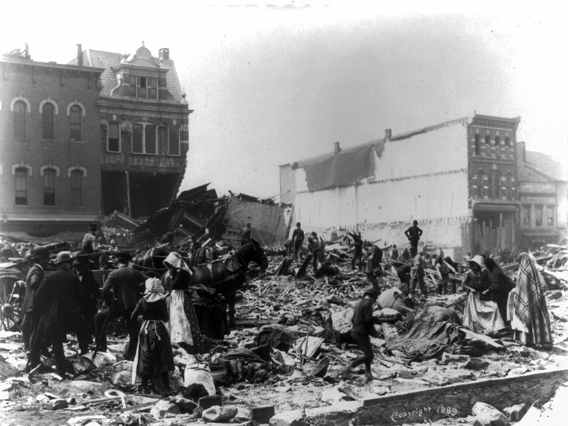 Black-and-white photo of people assessing damage from the 1889 Johnstown Flood
