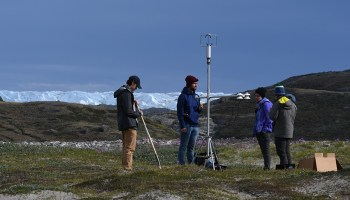 Undergraduate researchers prepare to take radiation measurements during their expedition to the Greenland Ice Sheet last June.