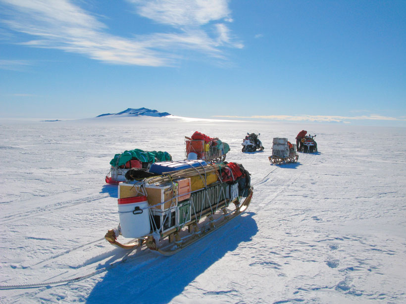 A science team moves equipment on sledges across the Thwaites Glacier in Antarctica in 2019.