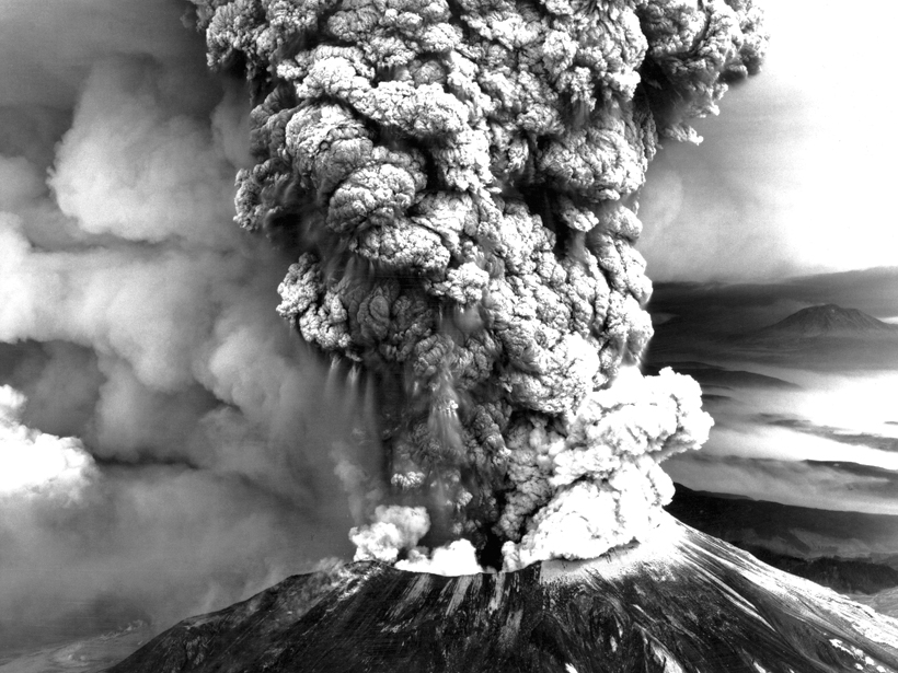 Black-and-white image of Mount St. Helens in 1980 with a billowing ash plume