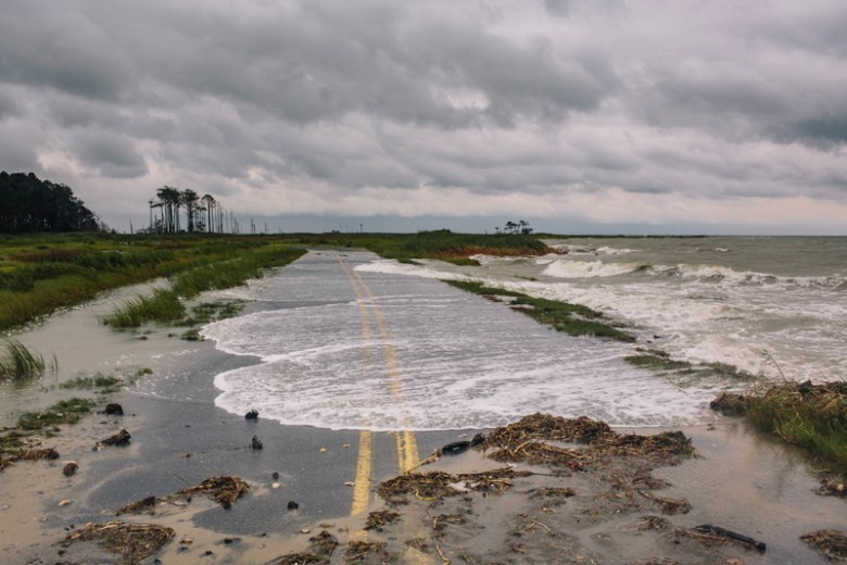 Water spills onto Hoopers Island Road, in Hoopersville, Md. during high tide.