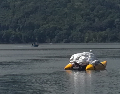 An instrument raft floats on the placid surface of Laacher See.