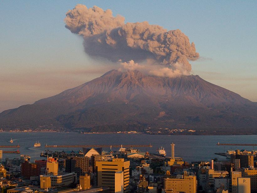 Sakurajima volcano emits a cloud of ash