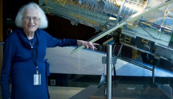 Nancy Grace Roman stands in front of a scale model of the Hubble Space Telescope