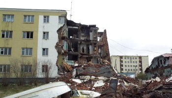Picture of collapsed corner of four-story apartment