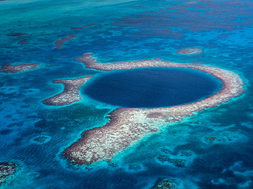 Aerial image of the Great Blue Hole in the Caribbean Sea off the coast of Belize
