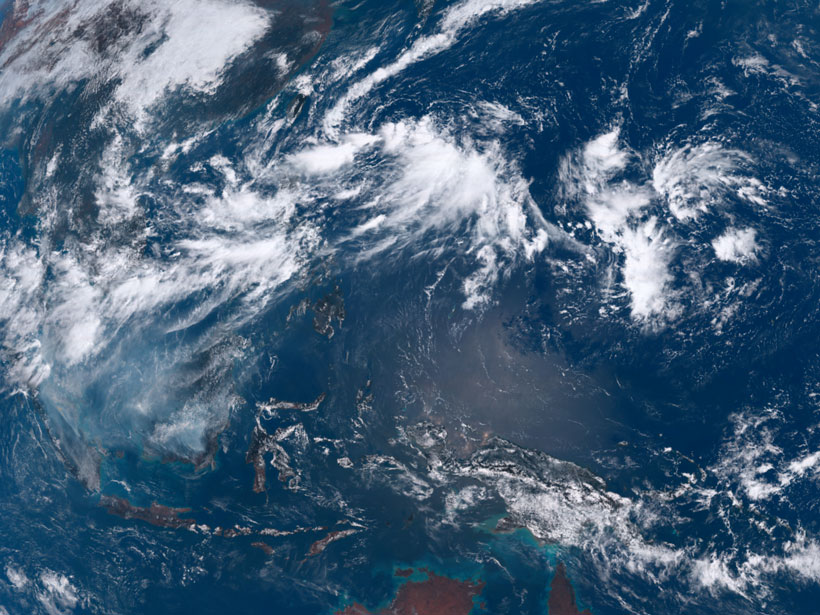 Satellite imagery showing the clouds of convective weather systems over Southeast Asia and the Philippine Sea on 18 September 2019
