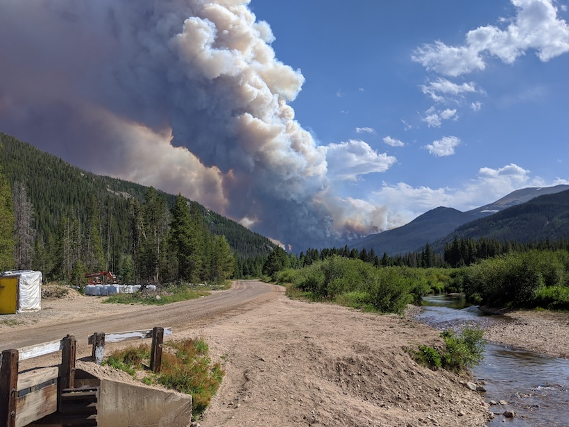 Smoke billows from a wildfire in the Rocky Mountains