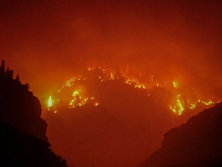 The Grizzly Creek Fire blazes in Glenwood Canyon, lighting up the night sky