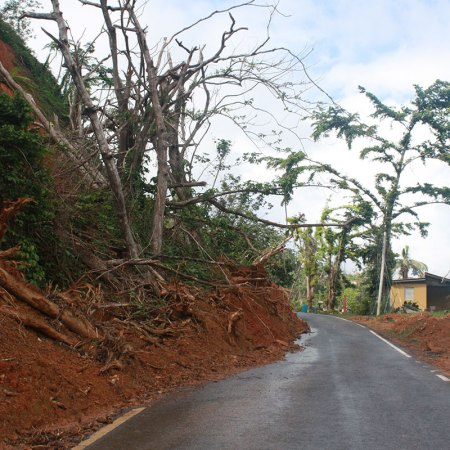 A rainfall-induced landslide that blocked a road after Hurricane Maria in Puerto Rico was cleared to let traffic through