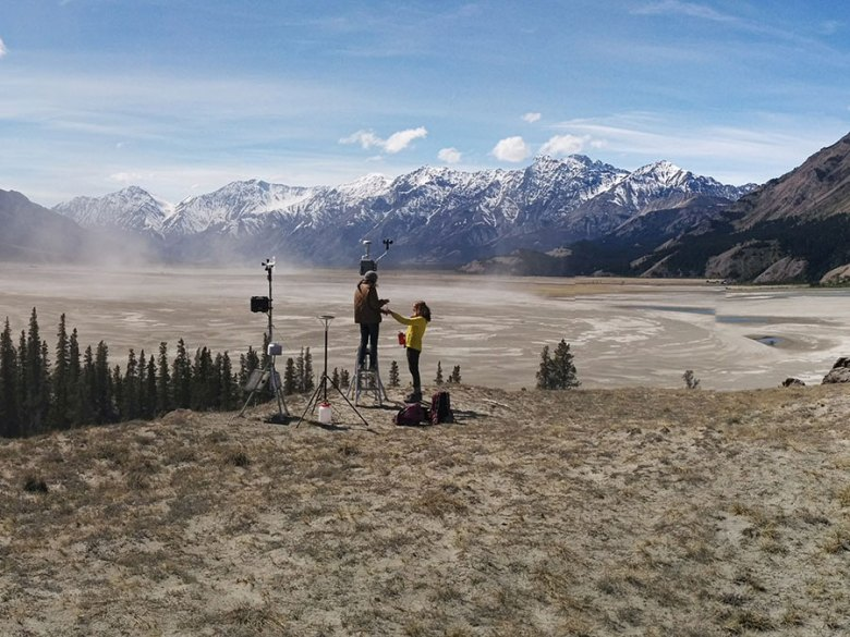 Scientists measuring air quality of the dust cloud over the Ä'äy Chù/Slims River formed by a retreating glacier in Yukon, Canada
