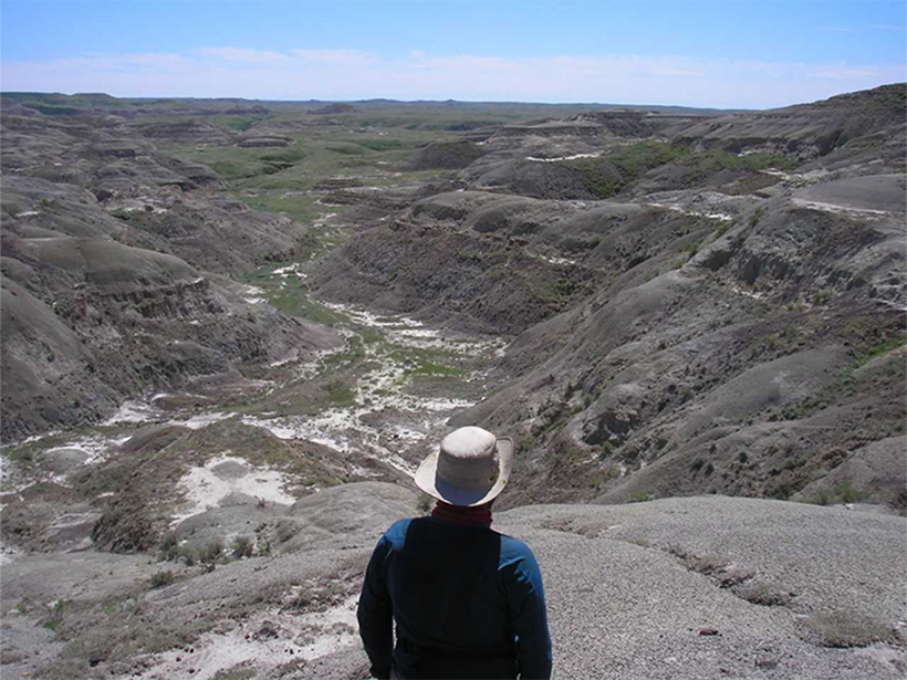 A researcher looks over Frenchman Valley, Chambery Coulee, Saskatchewan.