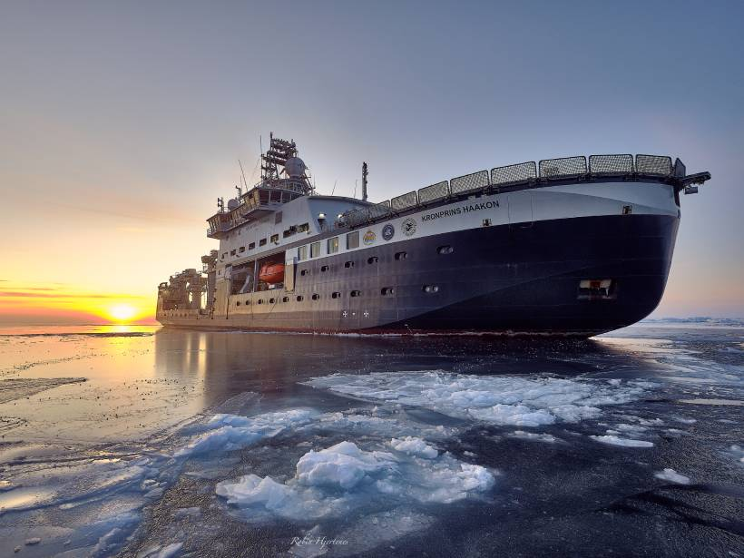 A research vessel in the Arctic at sunset