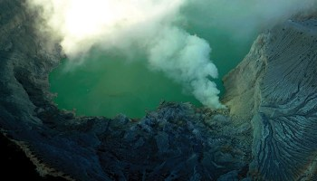 Steam and gas rise from a volcano on the island of Java, Indonesia.