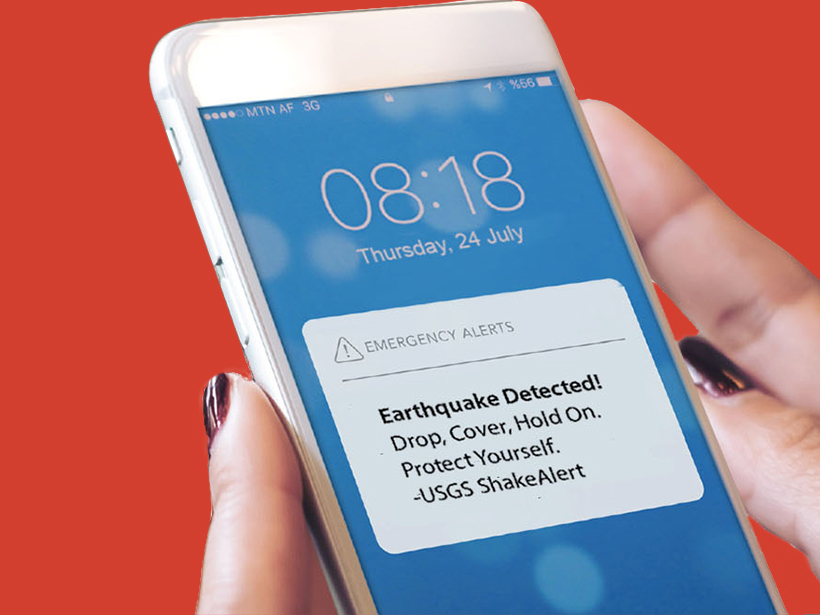 """Cell phone alert saying """"Earthquake Detected! Drop, Cover, Hold on. Protect Yourself -USGS ShakeAlert"""""""