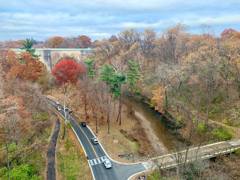 Cars drive through Rock Creek Park in Washington, D.C., as seen from a bridge.