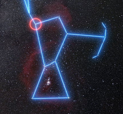 The stars of the constellation Orion are connected by blue lines as they sit amid an image of the surrounding star field and nebulae. Betelgeuse, at Orion's right shoulder, is circled in red.