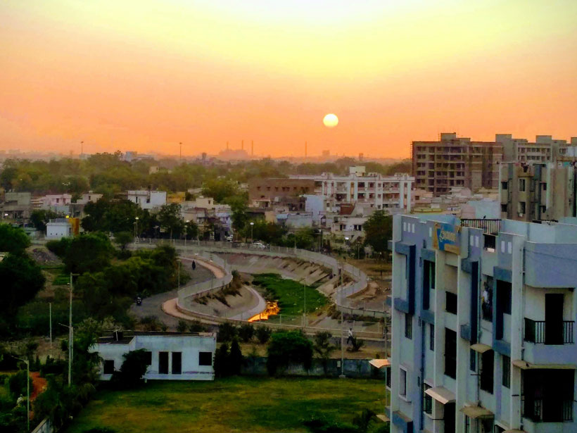 A cityscape of Ahmedabad, India, by sunset.