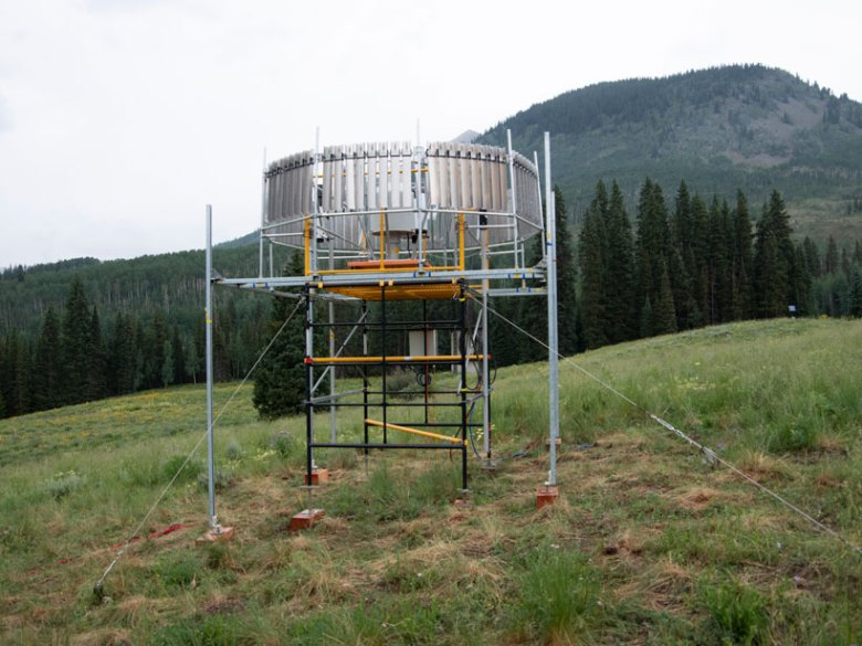 Platform holding instruments, including a rain gauge, in Gothic, Colo.