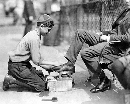 Image result for a man and a boy polishing shoes