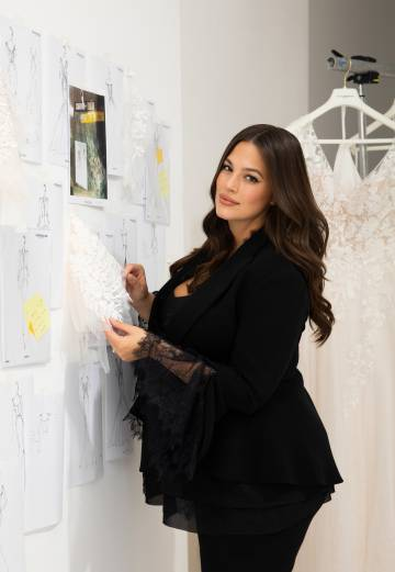 Ashley Graham, along with sketches of her new collection with Pronovias.