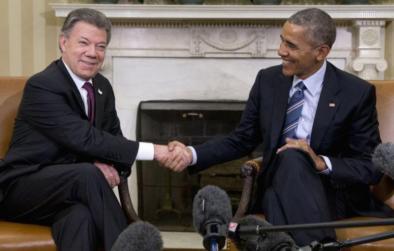 Obama y Santos, durante el acto