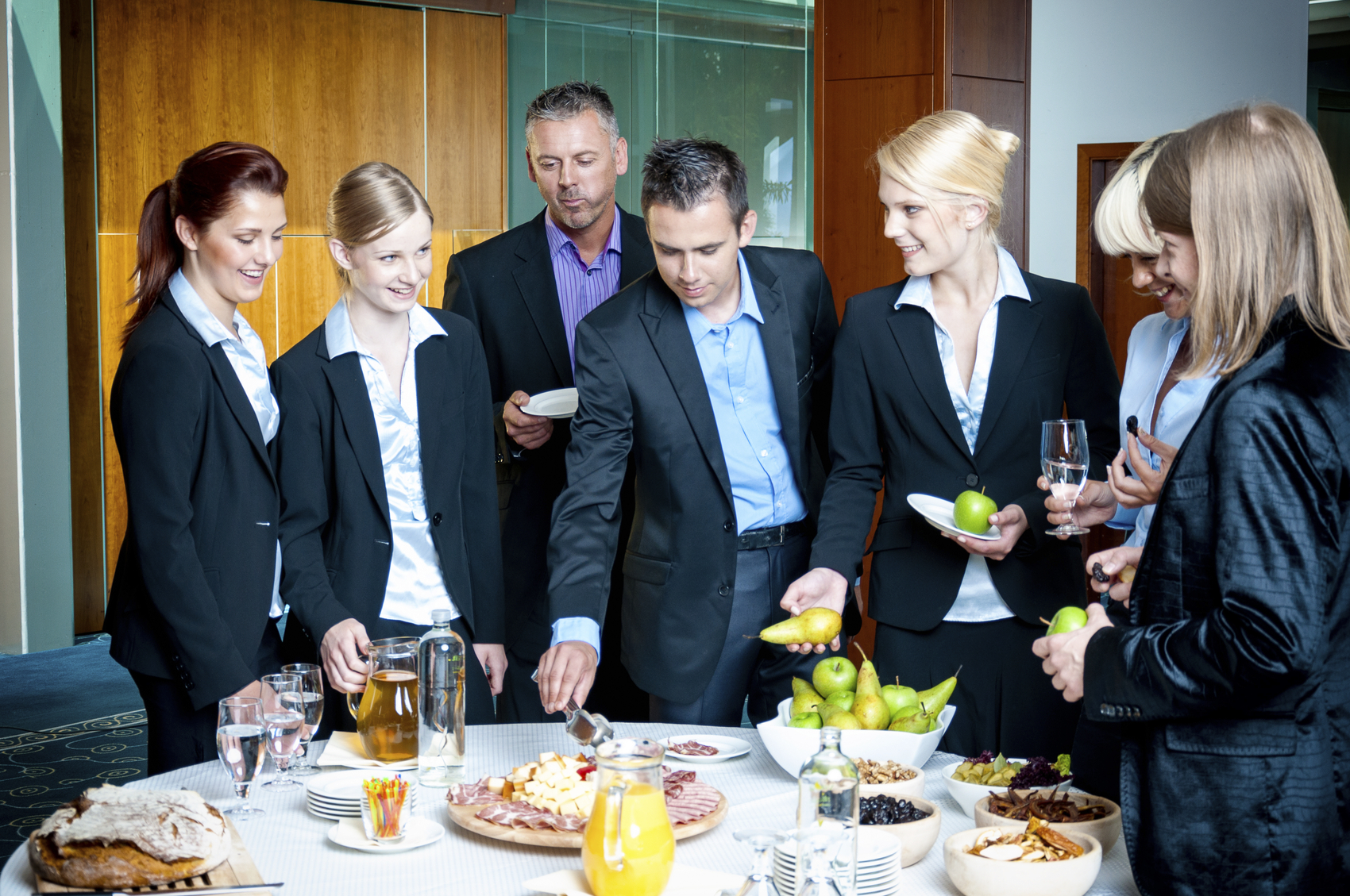 Epic Events by Booth, Inc. - Corporate Luncheon Event Planning - Business Team Having A Buffet Lunch