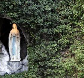 LOURDES, FRANCE - SEPTEMBER 12: The Statue of Our Lady of Lourdes at the entrance to the Grotto of Massabielle on September 12, 2008 in Lourdes, France. Pope Benedict XVI will arrive here for the 150th anniversary of the Vatican-recognized apparitions of the Virgin Mary. Pope Benedict XVI begins his first official visit to France today in Paris. (Photo by Carsten Koall/Getty Images)