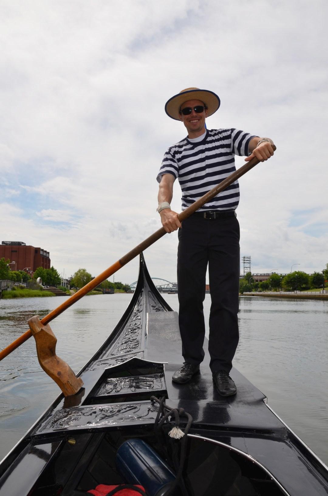 Marcello padding the gondola.